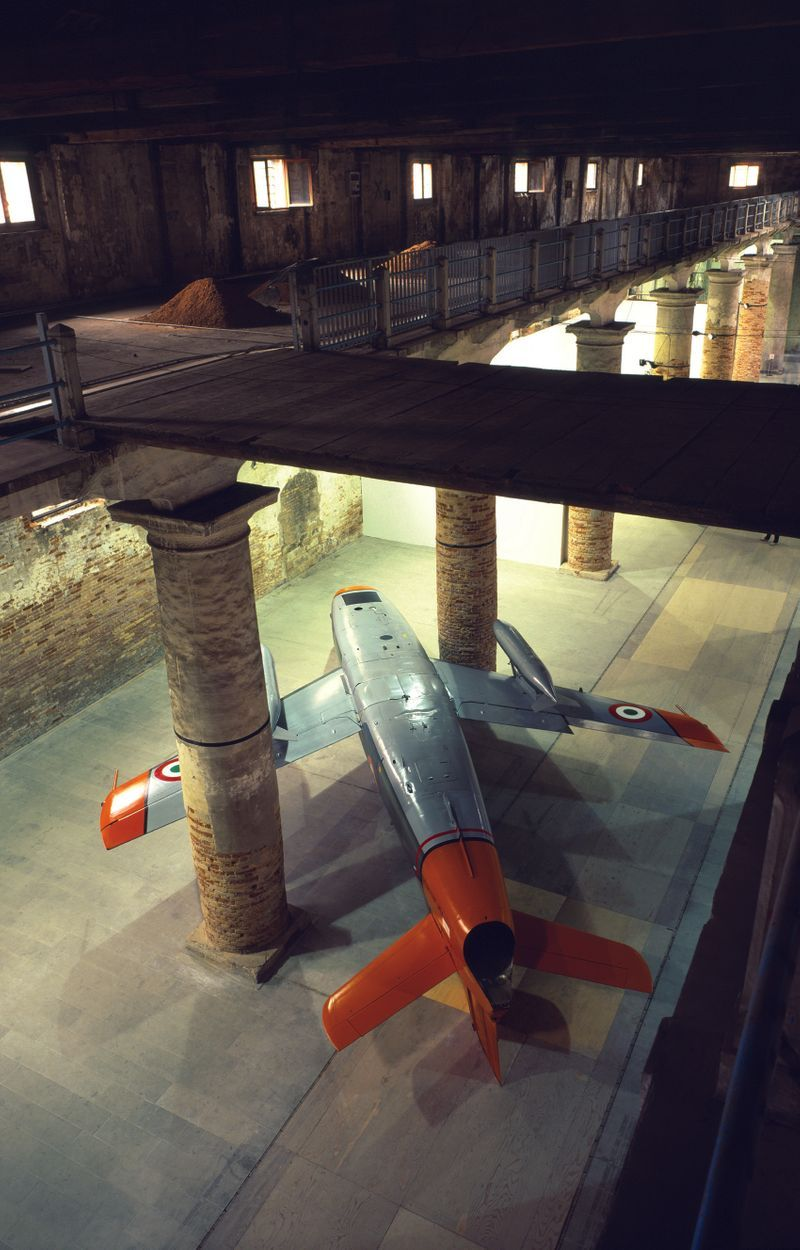 The upside down Fiat G-91 fighter jetfrom 1999 was shown at the Venice Biennal curated by Harald Szeemann in 1999. Paola Pivi won the Golden Lion award for best national Pavilion.