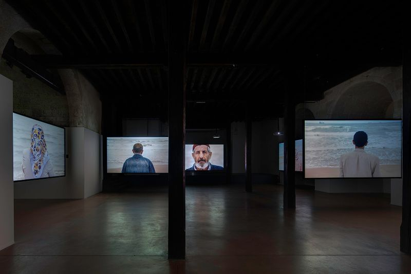 Installation view in Arles. Videoprojections on screens.