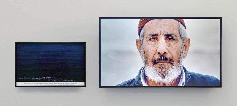 "Sophie CALLE ""Voir la mer. Old Man"" 20113'11"" digital film with color and sound, TV screen (52,5 x 91 x 13 cm), framed color photograph (33,5 x 52,5 x 2,5 cm)"