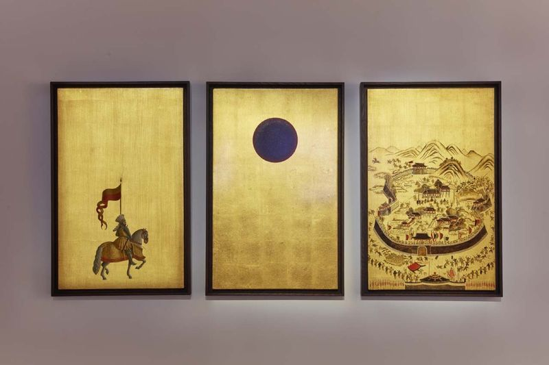 """Studies into the Past""  / Oil and gold leaf on wood / 65 x 42 cm,  25 9/16 x 16 9/16 inches (Each) / Unique This triptych refers directly to the traditional form of folding screens, composed of painting on a gilded background of gold leaf. It consists of three panels, each containing a different element: on the left, a horse rider holding a watchful stance; in the centre, a black sun filling the upper part of the panel; on the right, a landscape of a battle. Altogether, the screens form a strange landscape that the viewer pieces together whilst making associations with the various formal, cultural and temporal techniques evoked."