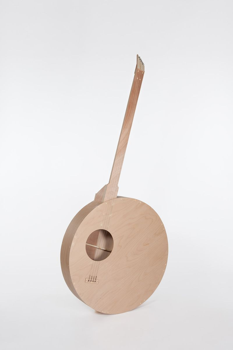 """""""Instrument 03 (Rond - basse ou banjo)"""" / Instrument 03 (Round - bass or banjo)"""", 2017 / Contreplaqué de hêtre, contreplaqué d'okoumé, sapin, éléments mécaniques, acier / Beech plywood, okoumé plywood, fir, mechanical elements, steel / 250 x 115 x 23 cm / 98 7/16 x 45 1/4 x 9 1/16 in / Unique artwork"""