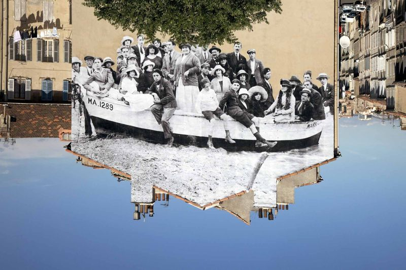 UNFRAMED, a group posing in a bark moored on the beach, reviewed by JR, circa 1930, Marseille, France , 2013Color photograph, mat plexiglas, aluminium, woodh. 180 × L. 270 cm | h. 70 3/4 in × l. 8.86 ft3/3 + 2AP
