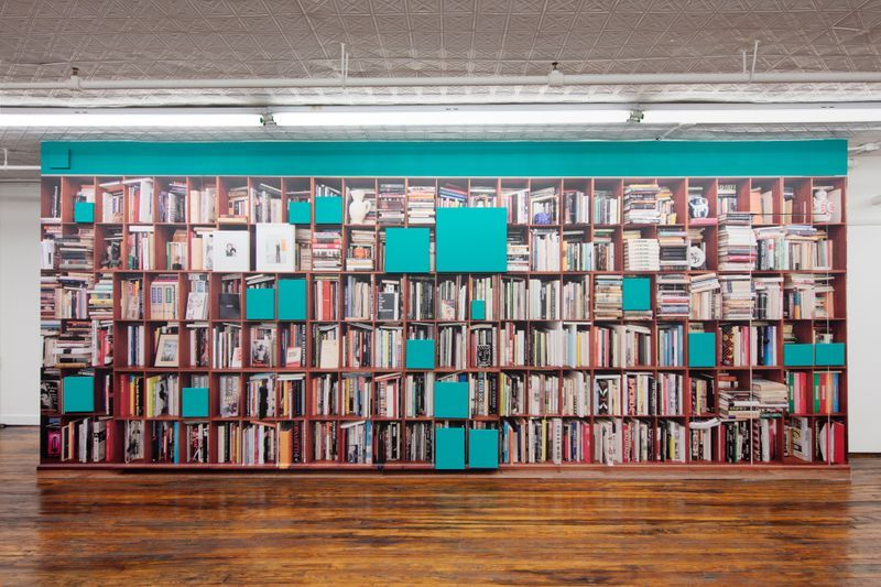 """Installation view of Claude Rutault's """"Bookshelves (A Portrait From Afar),"""" 2019 in """"Glenn O'Brien: Center Stage"""" at Off Paradise."""