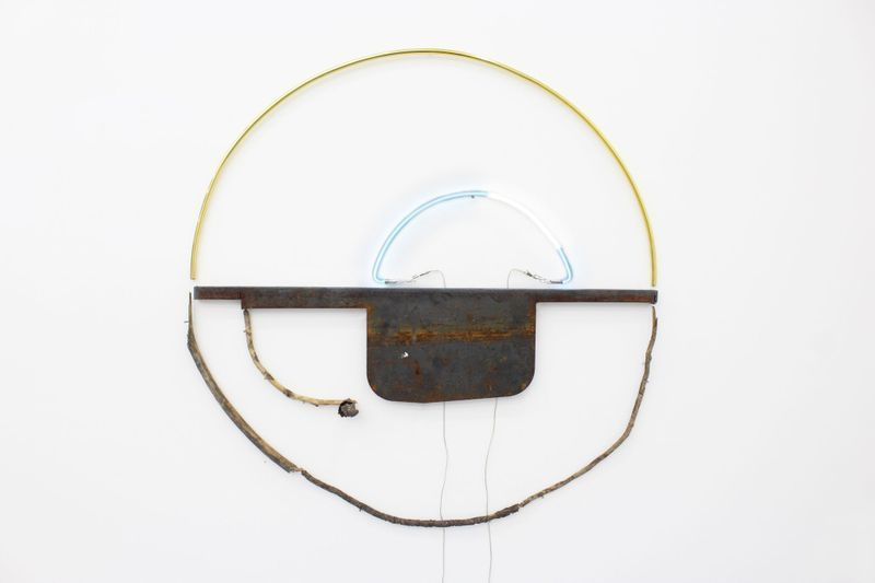 "Gabriel Rico, III - from the series ""Let not the judge meet the cause halfway"", 2019.Brass, branch, neon, steel.83 x 80 x 5 cm 