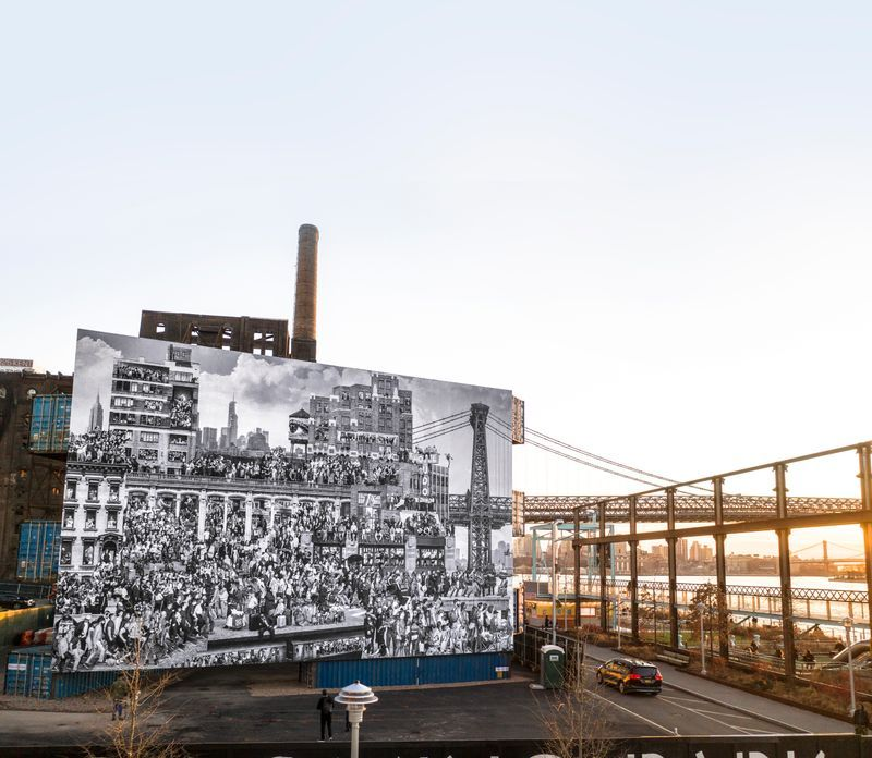 Installation view, The Chronicles of New York City, JR, and Triangle STACK #2, LOT-EK at Domino Park, Brooklyn, New York