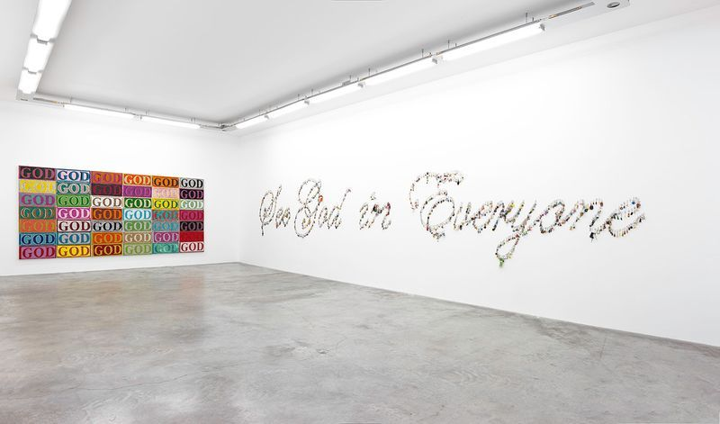 """View of the exhibition """" FIRE OF JOY """", Galerie Perrotin, Paris,  2012On left : """"God in Color"""", 2012 / Hand embroidery on canvas / 232 x 474 cm x 5 cm,  7.7 feet x 15.6 feet x 2 inches (6 panels : 232 x 70 x 5 cm) / Unique  On right : """"See God in Everyone"""", 2012 / Keychains / 10m30 x 180 cm, 33.8 feet x 70 7/8 inches / Unique"""