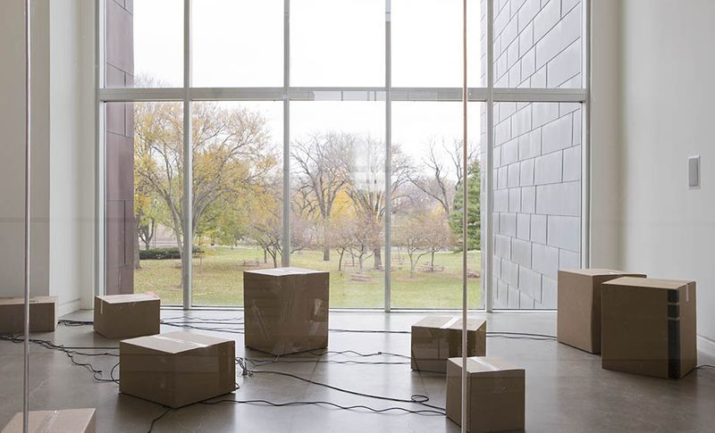 """View of the exhibition """"It Might as Well be Spring"""" at Rochester Art Center, Rochester (U.S.A.), 2014-2015""""Dave"""", 2014 / Audio speakers, audio sequencers, computer, cardboard boxes"""