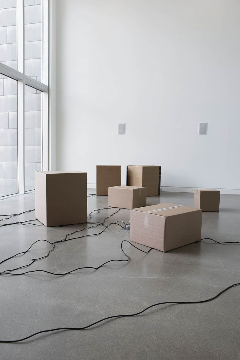 "View of the exhibition ""It Might as Well be Spring"" at Rochester Art Center, Rochester (U.S.A.), 2014-2015""Dave"", 2014 / Audio speakers, audio sequencers, computer, cardboard boxes"