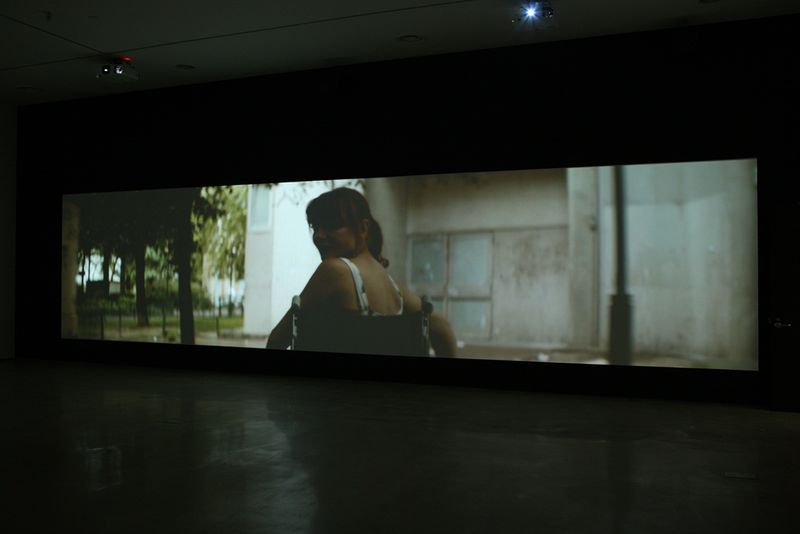 "View of the exhibition ""This Is a Landscape of Desire"" at The National Museum of Modern and Contemporary Art, Seoul (South Korea ), 2014""This Nameless Spectacle"", 2011 / HD, Two channel video installation with two opposed screens / 13'00"""