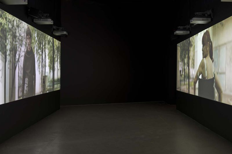 """View of the exhibition """" Jesper Just - APPEARING / INTERCOURSES """" at ARoS, Aarhus (Denmark), 2014""""This Nameless Spectacle"""", 2011 / HD, Two channel video installation with two opposed screens / 13'00"""""""