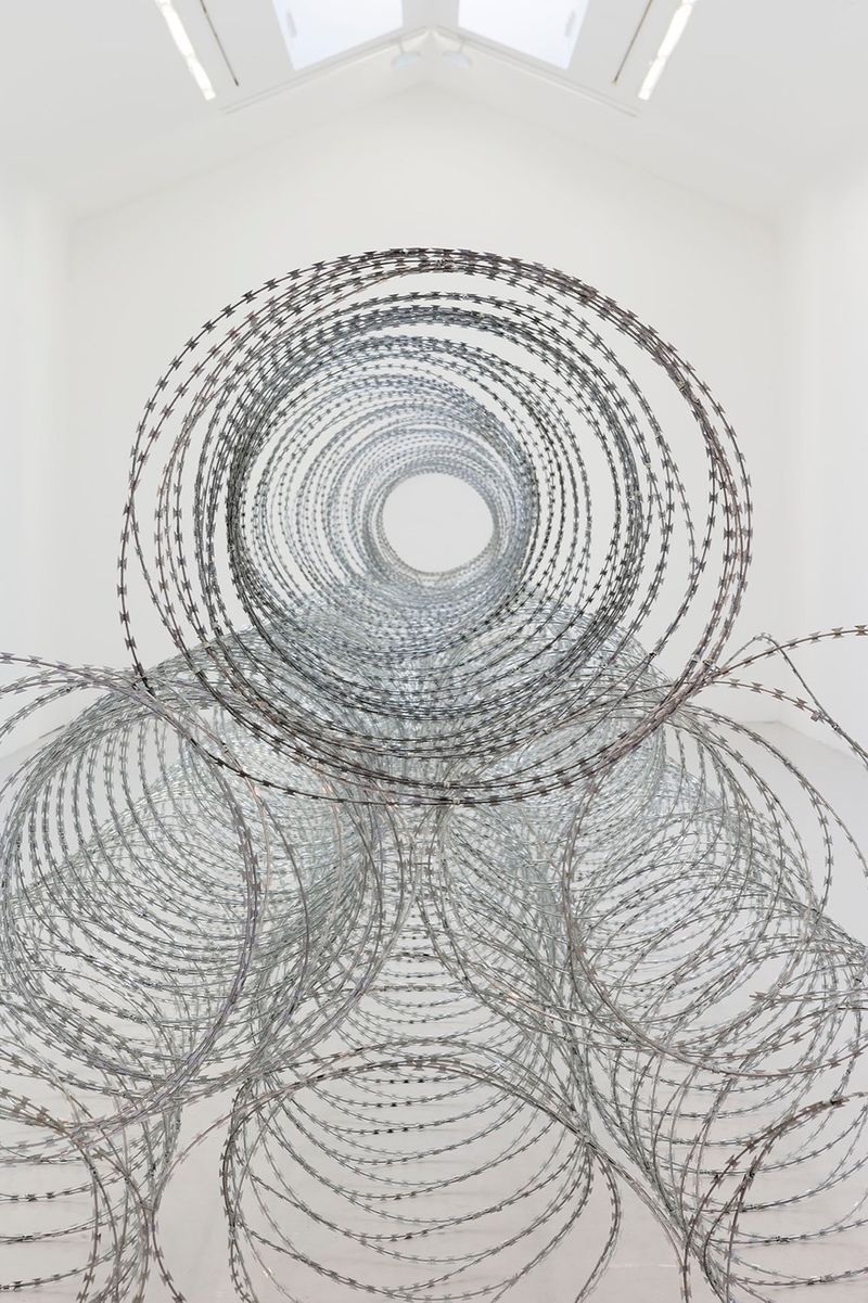 """View of the exhibition Draft at Galerie Perrotin - Saint Claude  Paris (France), 2015""""Draft - 1"""", 2015 / razor barbed wire / 200 x 1600 x 200 cm; 78 3/4 x 629 15/16 x 78 3/4 in / Unique  (From a series of three unique works - produced in variable dimensions according to the actualization)"""