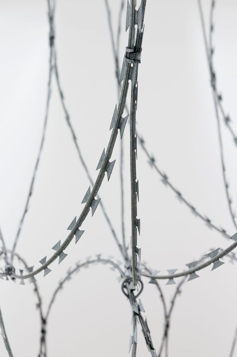 """View of the exhibition Draft at Galerie Perrotin - Saint Claude  Paris (France), 2015 """"Draft - 3"""", 2015 / razor barbed wire / 280 x 260 x 70 cm; 110 1/4 x 102 3/8 x 27 9/16 in / Unique (From a series of three unique works - produced in variable dimensions according to the actualization)"""
