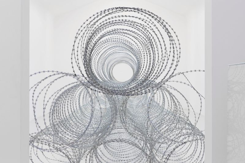 """View of the exhibition Draft at Galerie Perrotin - Saint Claude  Paris (France), 2015 """"Draft - 1"""", 2015 / razor barbed wire / 200 x 1600 x 200 cm; 78 3/4 x 629 15/16 x 78 3/4 in / Unique  (From a series of three unique works - produced in variable dimensions according to the actualization)"""